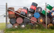AKRANES, ICELAND - AUGUST 1, 2016: Oil barrels or chemical drums stacked up f Stock Photos