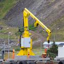 Fishing crane in small seaside Iceland town harbor Stock Photos