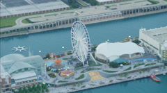 Aerial view of Lake Michigan Navy Pier fair and Ferris wheel Chicago Waterfront Stock Footage