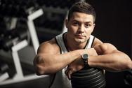 Confident good looking weightlifter having a workout Stock Photos