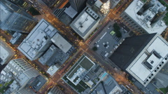 Aerial vertical overhead rooftop illuminated dusk view of Metropolitan Chicago Stock Footage