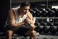 Thoughtful serious sportsman sitting in a gym Stock Photos