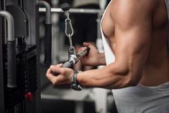 Well built athletic man standing near gym apparatus Stock Photos
