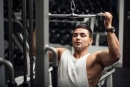 Persistent serious man training in a gym Stock Photos