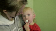 Girl with a Pacifier in the Arms of her Mother Looking at the camera Stock Footage