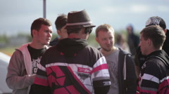 Group of men discussing something with the racing judges Stock Footage