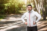 Joyful delighted man enjoying early morning run Stock Photos