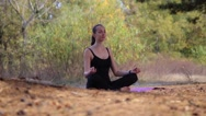 Beautiful female making yoga in forest Stock Footage