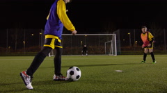 March 2016. British youth soccer team training on floodlit pitch at night Stock Footage