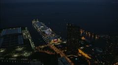 Aerial illuminated view of Lake Michigan Navy Pier fair and Ferris wheel Chicago Stock Footage