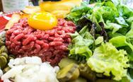 Tasty Steak tartare (Raw beef) - classic steak tartare on white plate Stock Photos