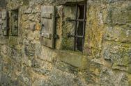 Stone wall with windows Stock Photos
