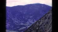1958: looking down on the beautiful view of steep rocky snow covered mountain. Stock Footage
