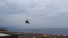 Helicopter Landing on the Platform Above the sea in Monaco Stock Footage
