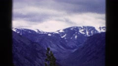 1958: mountain area is seen traveling by road MONTANA Stock Footage