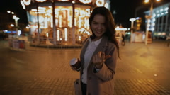 Romantic moment in night city. Woman show gesture - come to me. Stock Footage