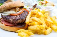 Cheese burger - American cheese burger with Golden French fries Stock Photos