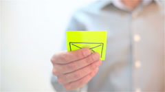 Mail, sms. A man sticks a note on transparent screen Stock Footage