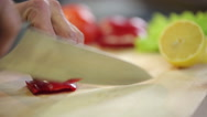 Knife chops red paprika Stock Footage