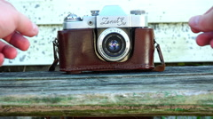 """Photographer adjusts the lens of the historical brand of the camera """"Zenit 3m"""" Stock Footage"""