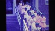 1972: children are seen having fun in garden area LYNBROOK, NEW YORK Stock Footage