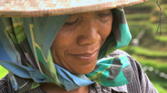 Face of Asian female in organic rice farm business wearing traditional clothing Stock Footage