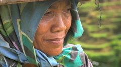 Face of Asian female in slow motion wearing traditional clothing in tropical Stock Footage