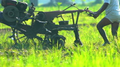 Java, Indonesia - August 2016: Slow motion of farmer ploughing soil with Stock Footage
