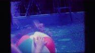 1972: mother and children playing in pool LYNBROOK, NEW YORK Stock Footage