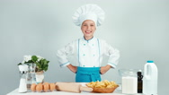 Portrait cute smiling chef cook girl enters the frame. Thumbs up. Ok Stock Footage