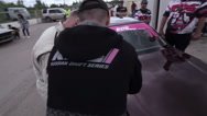 Racer glues membership number on the car Stock Footage