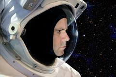 Astronaut on space mission with stars on the background Kuvituskuvat