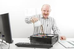 Crazy Businessman Pouring Coffee In Computer Chassis Stock Photos
