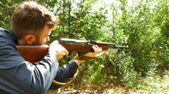 4K Man Shooting Rifle down range, Target Practice Sport Stock Footage