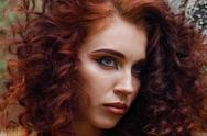 Face of pretty woman with makeup and curly hair outdoor, close up Stock Photos