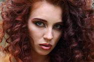 Face of pretty woman with makeup and curly red hair, close up Stock Photos