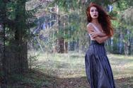 Sensual woman in skirt and belt poses on wind in sunny autumn forest Stock Photos