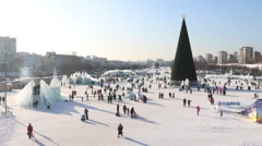 Ice town, walking people and Christmas tree in Perm, Russia at winter day Stock Footage