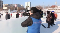 Russian television reporter works in Ice town Stock Footage