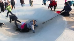 Children in big ice plate, Ice town in Perm - traditional winter attraction Stock Footage