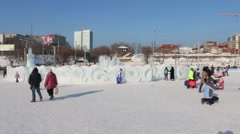 Ice sculptures and people, Ice town in Perm - traditional winter attraction Stock Footage