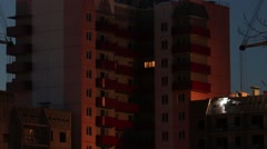 Welding work on roof of building under construction at night Stock Footage