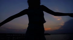 Silhouette of young beautiful Hispanic female enjoying leisure and dancing  Stock Footage