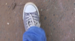 Feet on going man in jeans and sneakers, steps, top view Stock Footage