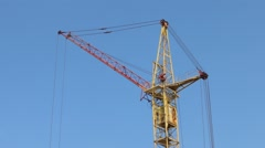 Part of turning stationary hoist on construction site, blue sky Stock Footage
