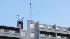 Part of grey apartment building of bearing-wall construction, hook of working Stock Footage