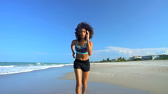 Young fit slim African American woman with afro hair enjoying jogging  Stock Footage