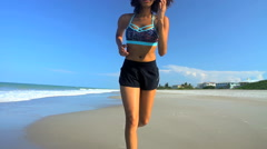 Young active slim African American female with afro hair enjoying running  Stock Footage