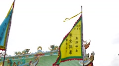 4K Chinese writing on flag by wind in phuket Vegetarian Festival 2016 Stock Footage