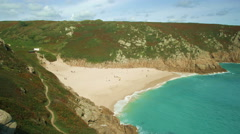 Porthcurno beach and Cornwall coast in England UK. Stock Footage
